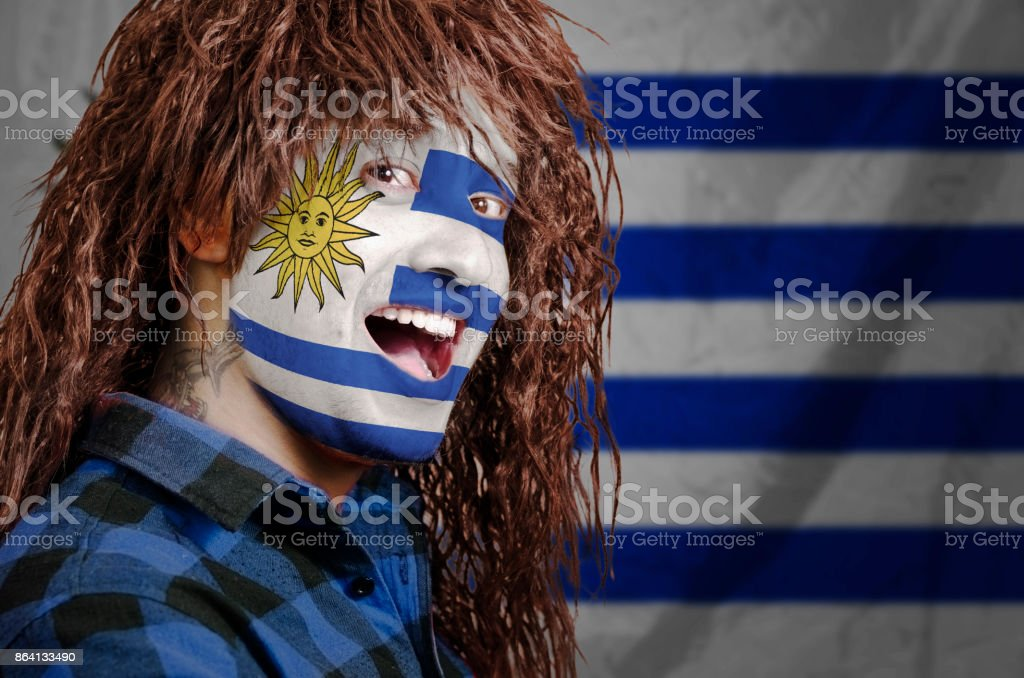 Uruguyan fan with face painted royalty-free stock photo