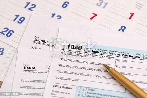 istock us 1040 tax form with calendar 520836594