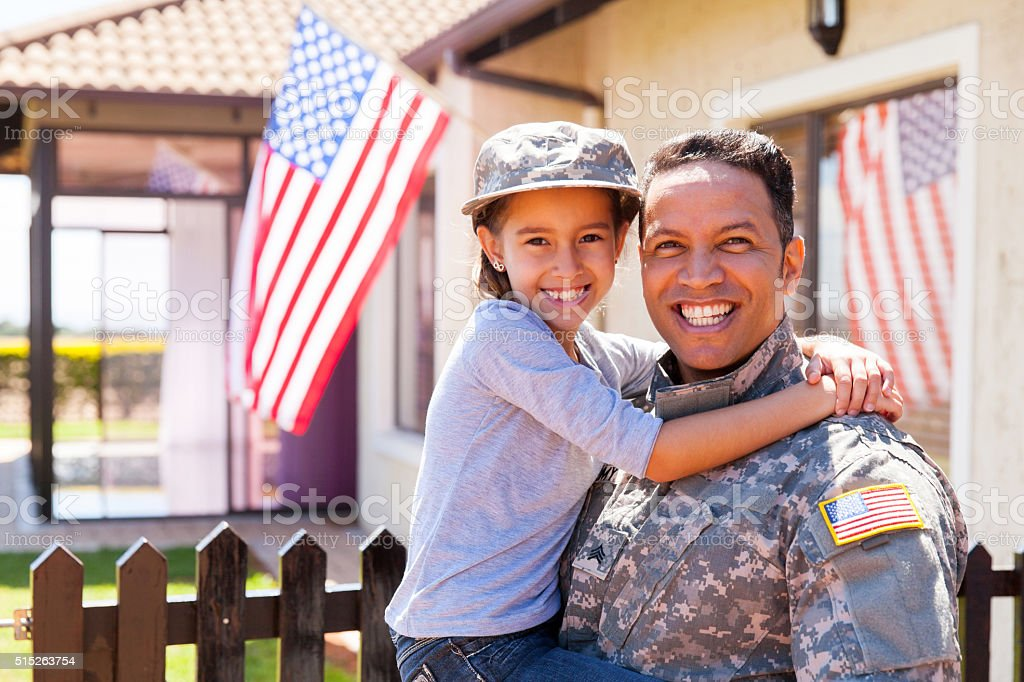 us army soldier and little daughter stock photo