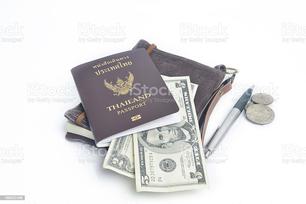 us dollar bills with Thailand passport royalty-free stock photo
