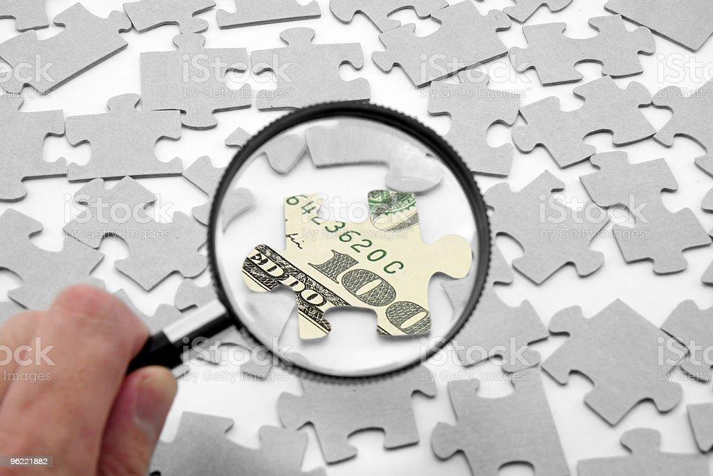 puzzle und Lupe us-dollar – Foto