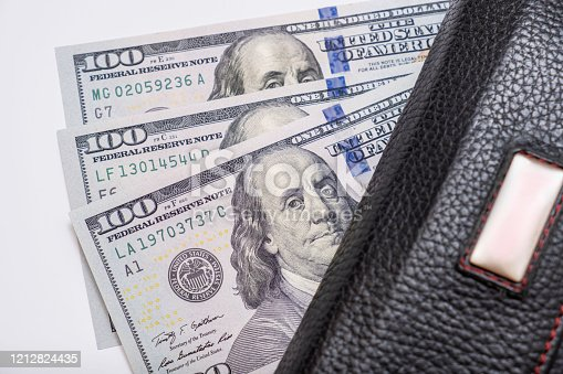 istock Us dollars banknotes in a wallet, earning and saving money concept 1212824435