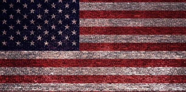 wir Flagge auf einer Ziegelwand – Foto