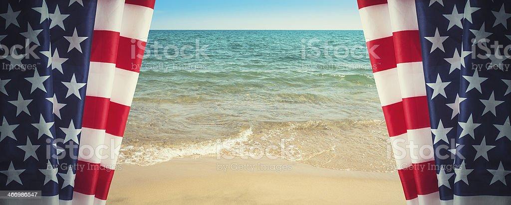 Us flag on beach background stock photo