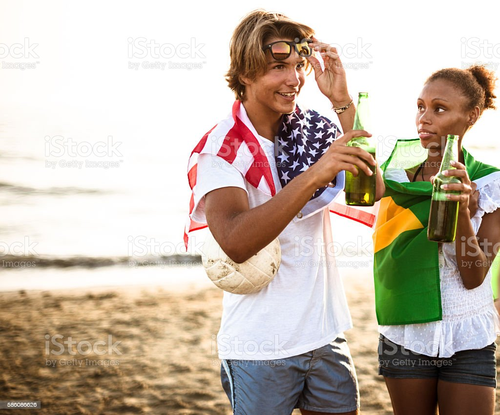 Us guy and brazilian woman embracing for fraternity stock photo