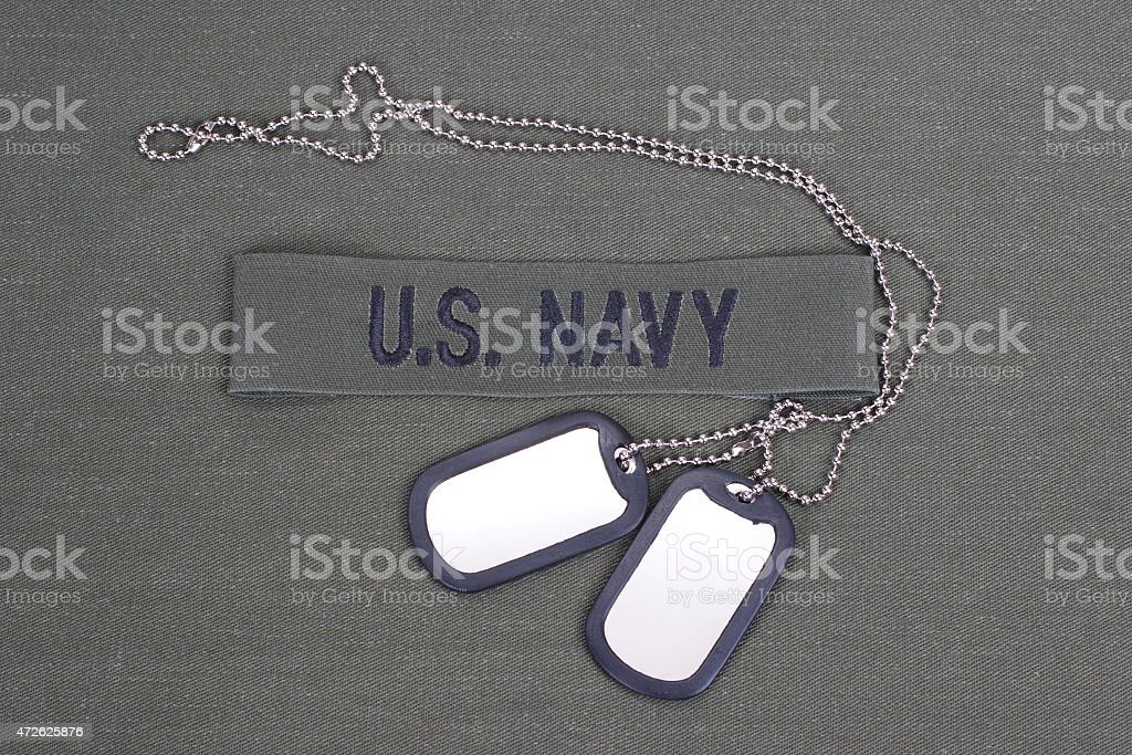 us navy uniform with blank dog tags stock photo