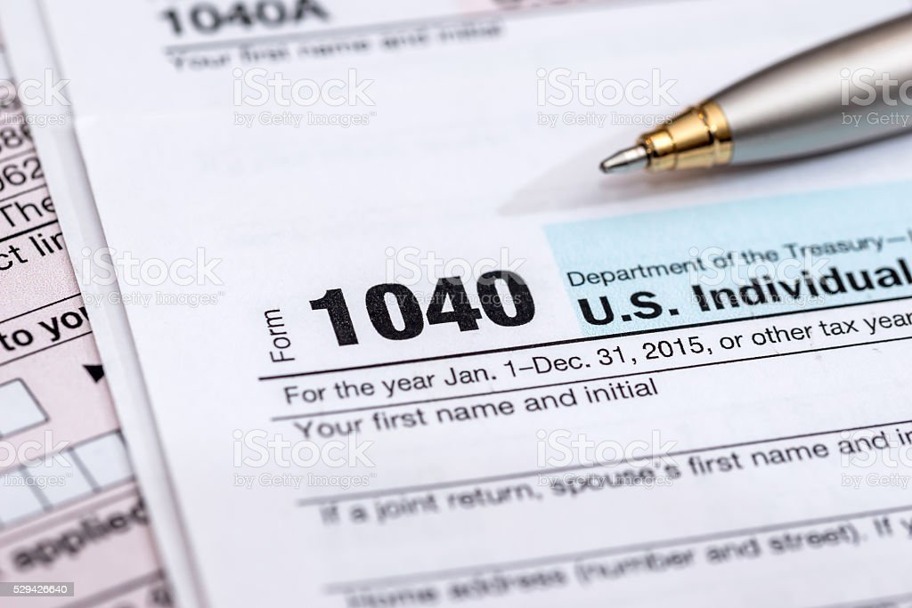 us tax form with pen stock photo