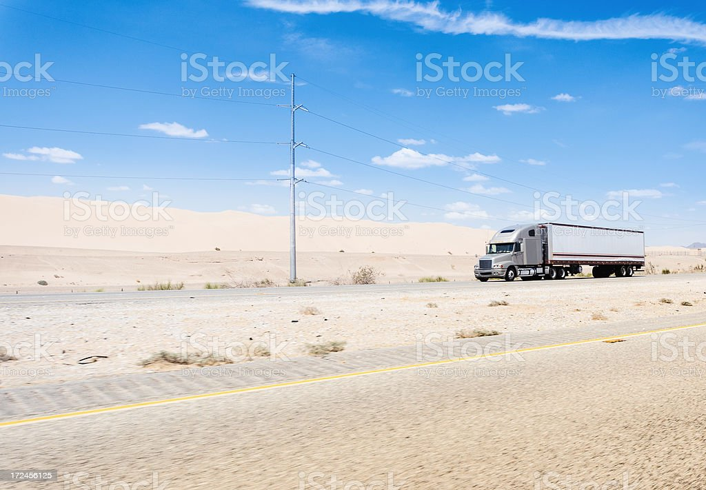 Us truck running on the nevada desert road royalty-free stock photo