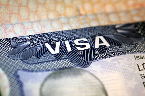 Us Visa macro view of an old US visa passport stamp stock pictures, royalty-free photos & images