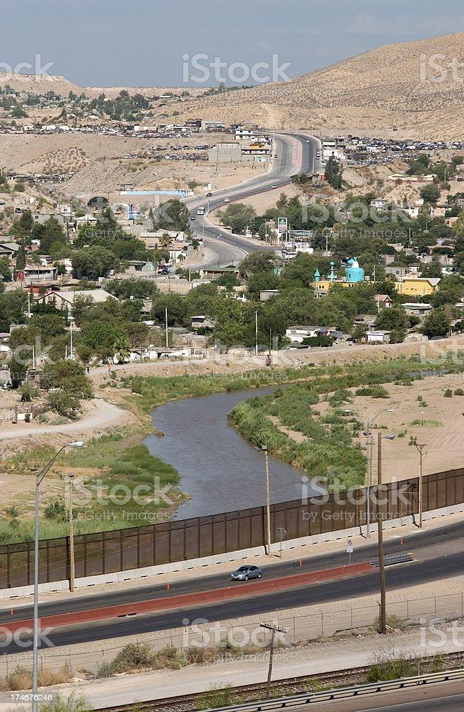 US_Mexico Border Fence along the Rio Grande River royalty-free stock photo