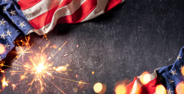 Usa Celebration With American Flag And Sparkler stock photo