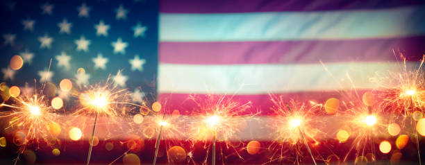 Usa Celebration With Sparklers And Blurred American Flag On Vintage Background Usa Celebration With Sparklers And Blurred American Flag On Vintage Background independence day stock pictures, royalty-free photos & images