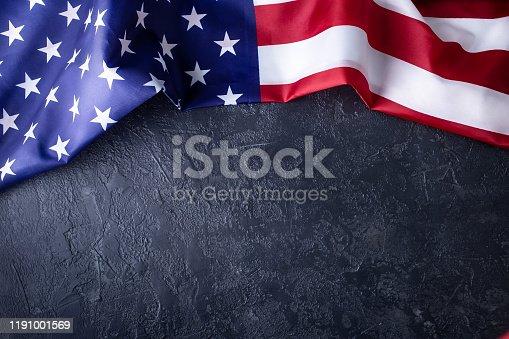 istock Usa flag on dark background 1191001569