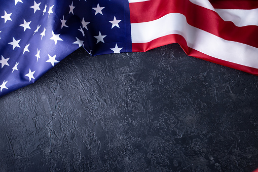 istock Usa flag on dark background 1191001569