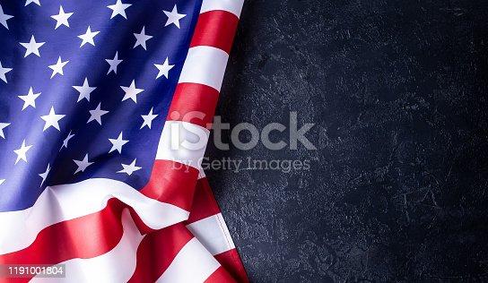 istock Usa flag on dark background 1191001804