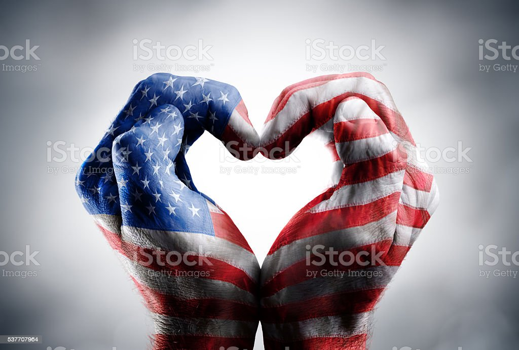 Usa Flag On Hands stock photo