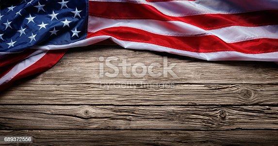 istock Usa Flag On Vintage Wooden Background 689372556