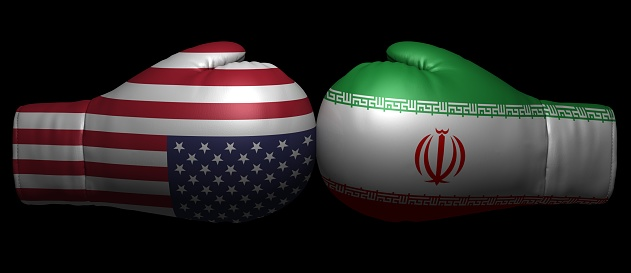 istock usa iran us sanctions trade war tariffs 3d flags conflict confrontation crisis sign symbol icon graphic isolated on black background 1063766286