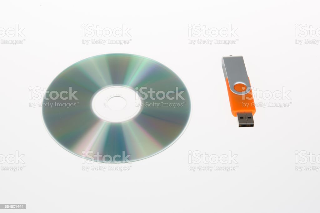Usb flash memory on disk isolated on white backround stock photo