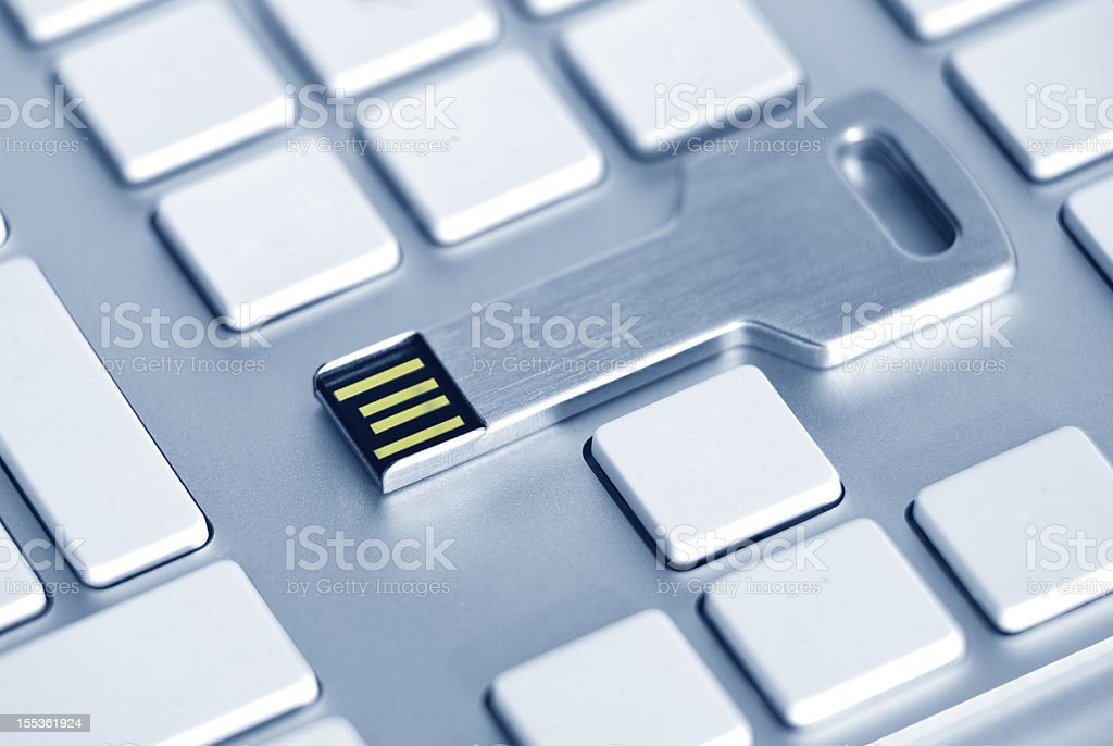 usb key on a blanc computer keyboard royalty-free stock photo