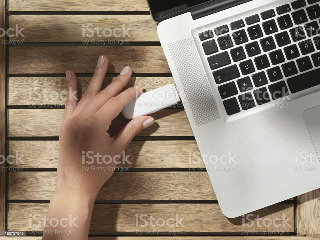 Usb memory plugged into a laptop stock photo