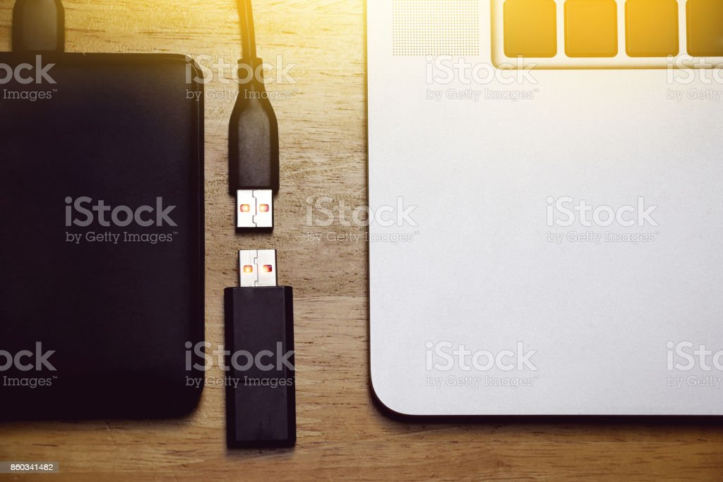 usb storage data, flash drive and external hard disk with computer notebook stock photo