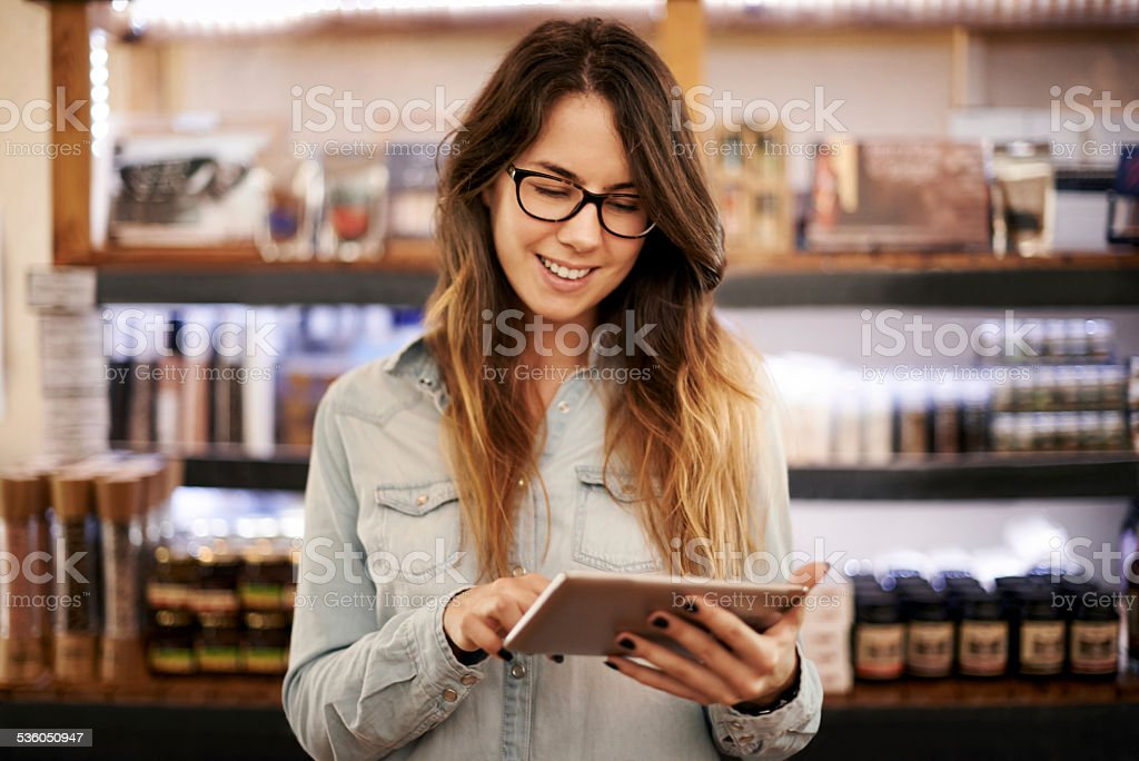 I use my tablet to run my store stock photo