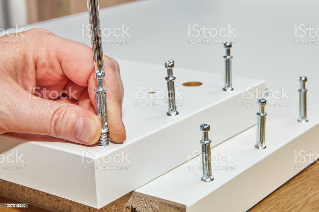 Use of furniture fasteners when installing a flat pack. stock photo