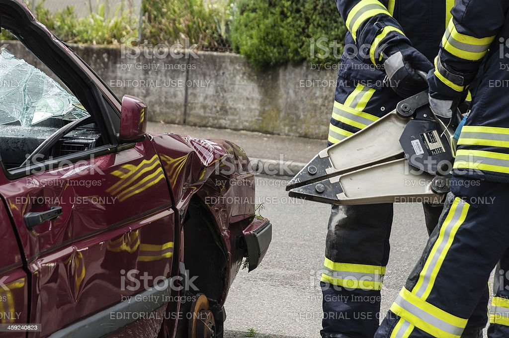 Use Of Hydraulic Rescue Tool Firefighters In Action Stock Photo