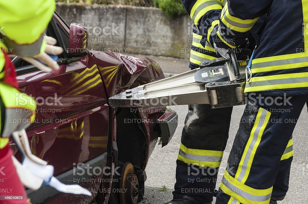 Use of hydraulic rescue tool. Firefighters in action. stock photo