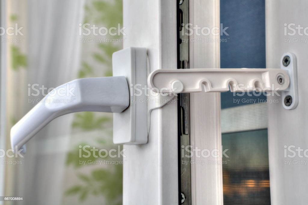 Use of restrictor opening PVC windows at airing the room. stock photo
