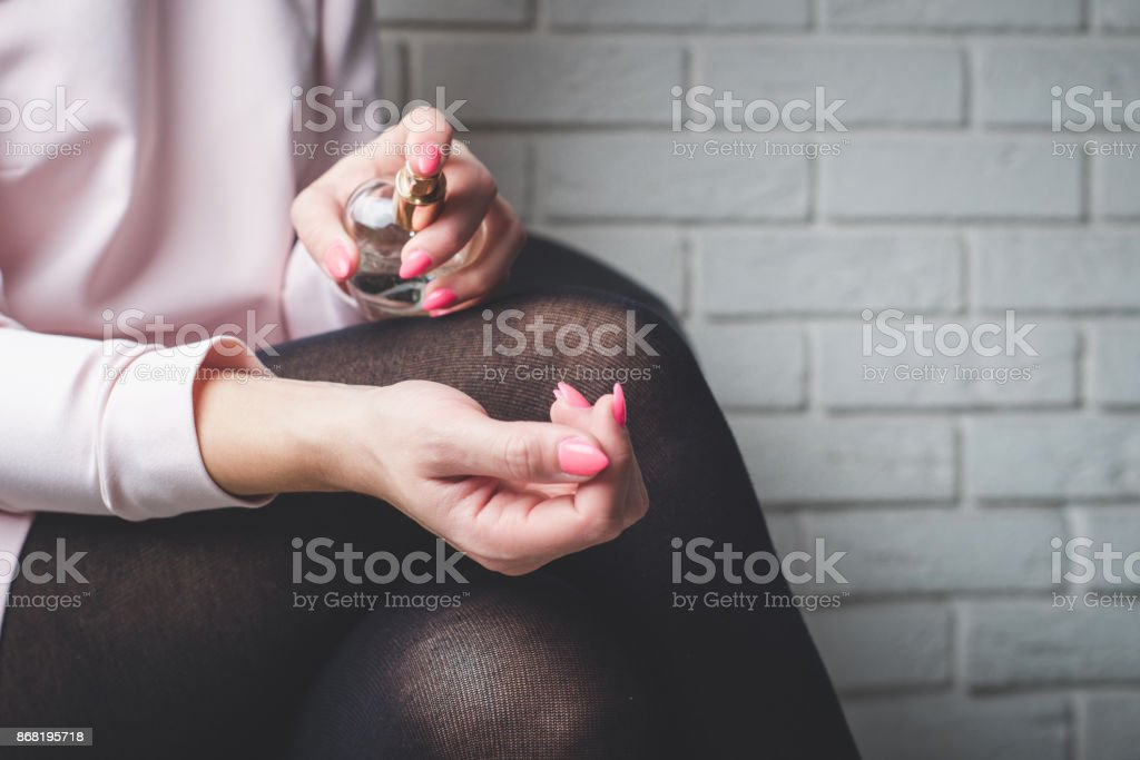 Use perfume on hand stock photo