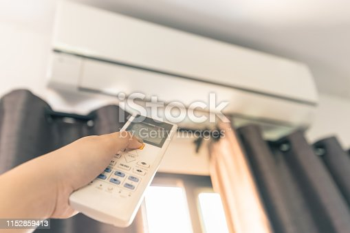 istock Use the Remote Control to Turn On the Air Conditioner 1152859413