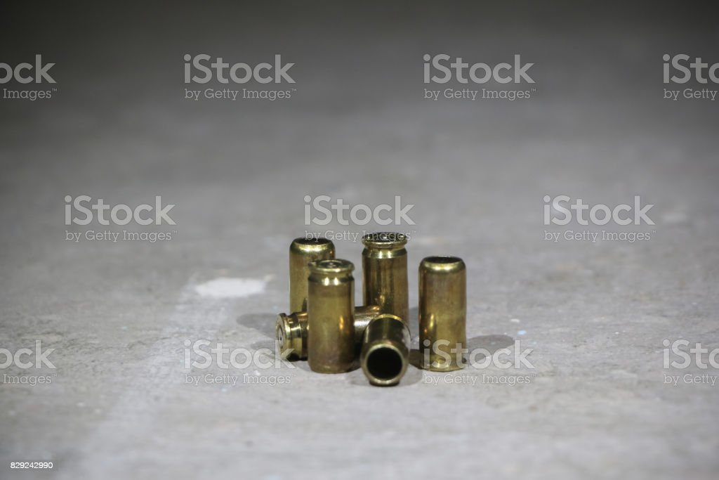 Used 9mm bullet casings on concrete stock photo