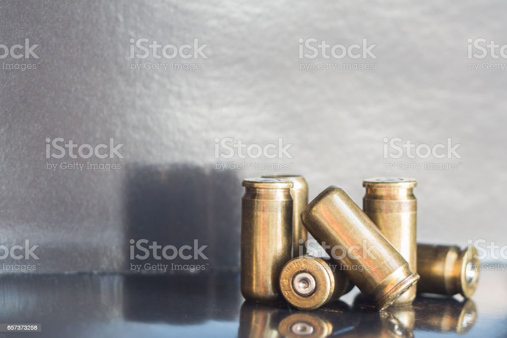 Used 9mm bullet casings on dark background stock photo