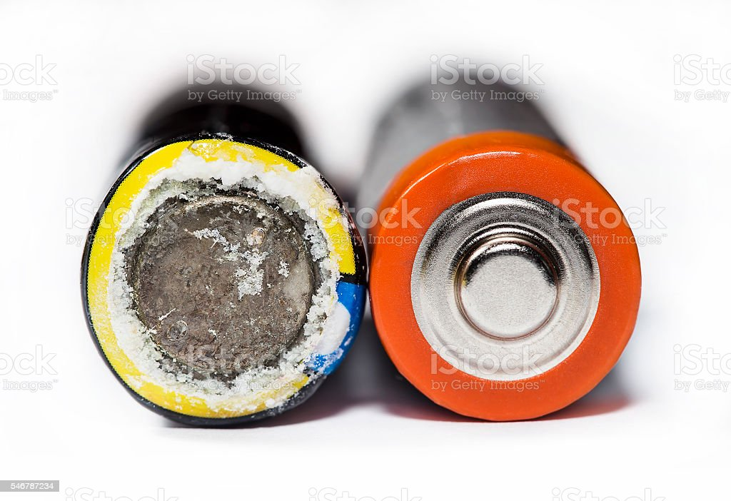 Used and leaking battery stock photo