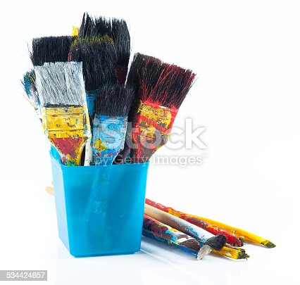 istock Used artist paintbrushes in a jar. 534424657