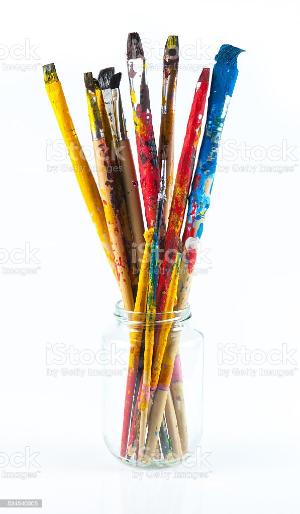 Used artist paintbrushes in a jar. stock photo