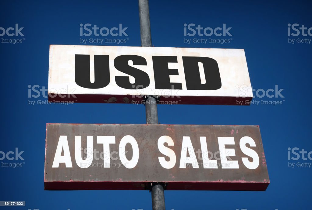 used auto sales sign stock photo
