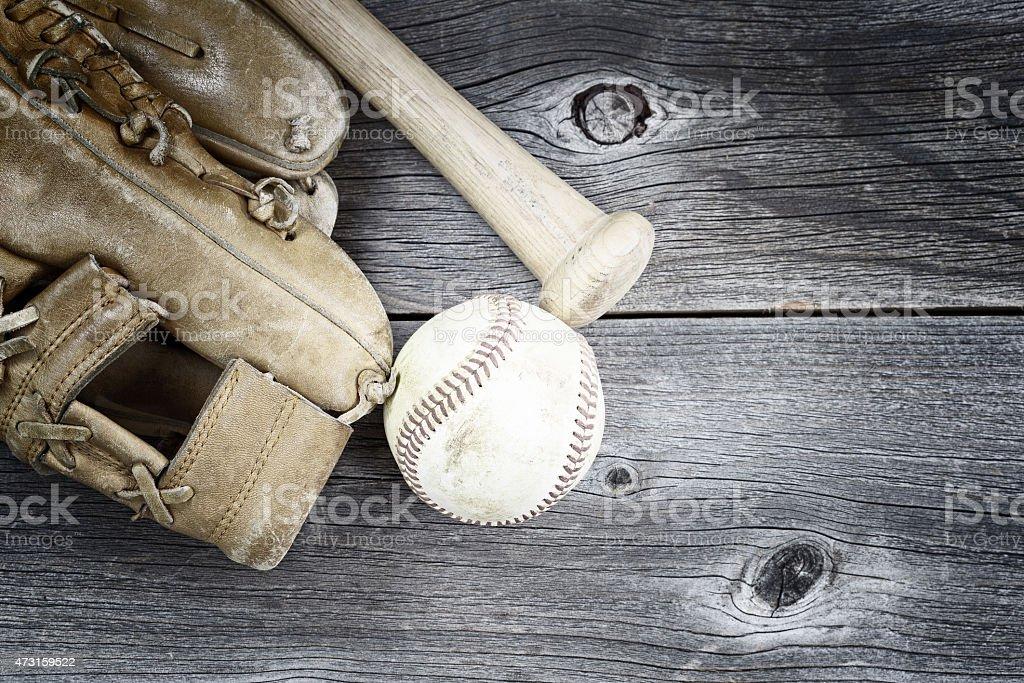 Used Baseball equipment on rustic wood stock photo