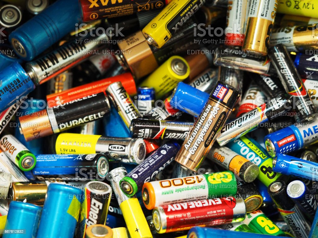 Used batteries from different companies, waste, collection and recycling, high danger for the environment. Batteries background stock photo