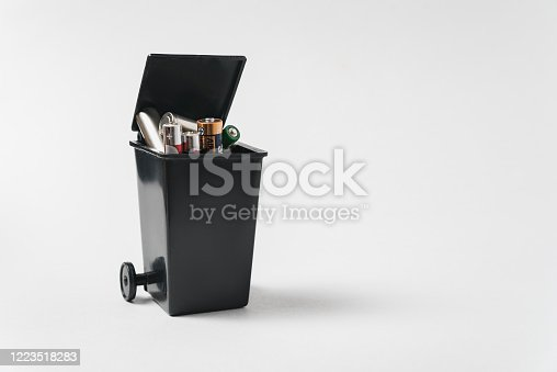 istock Used batteries in the bin on a white background. Electronic waste concept. 1223518283