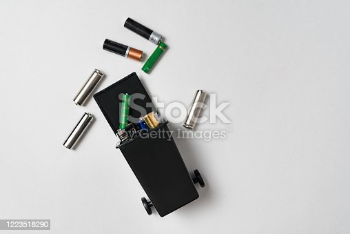 istock Used batteries in the bin on white background. Environmental pollution with toxic household waste 1223518290