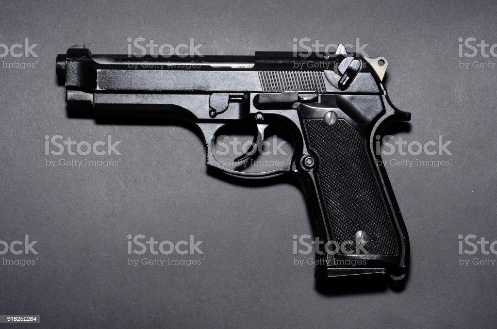 Used Black Metal 9mm Pistol Gun On Black Background Stock