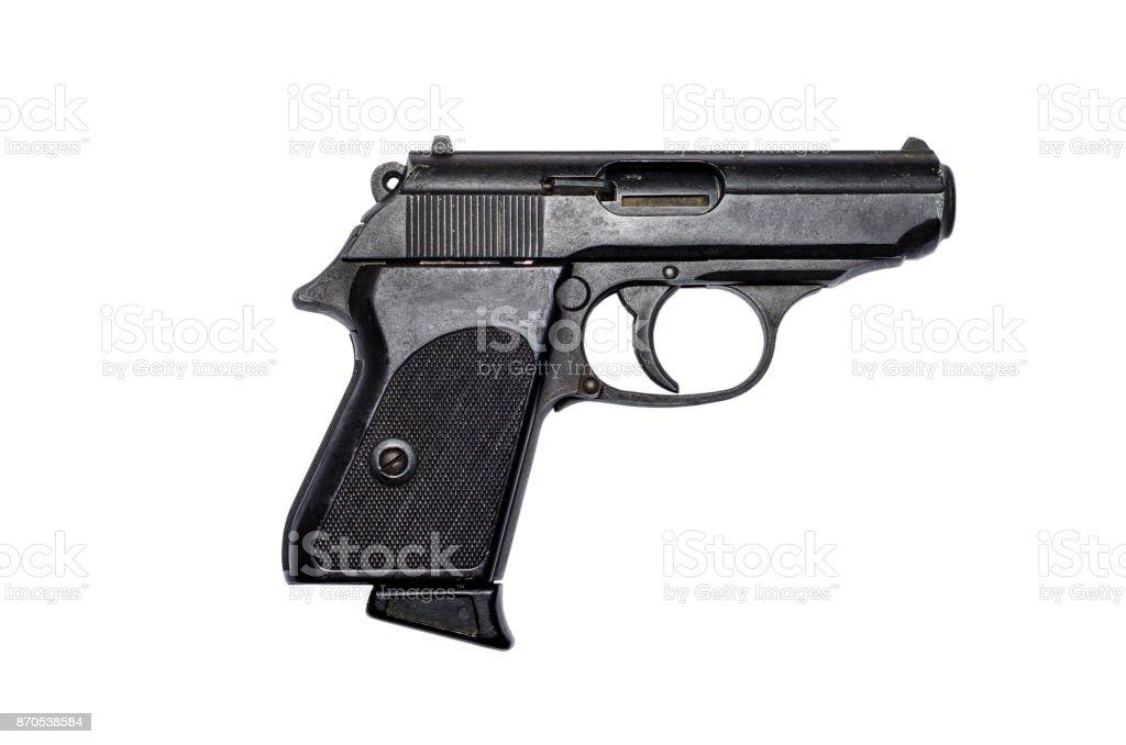 Used black metal pistol gun on white background stock photo