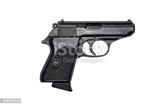 istock Used black metal pistol gun on white background 918252244
