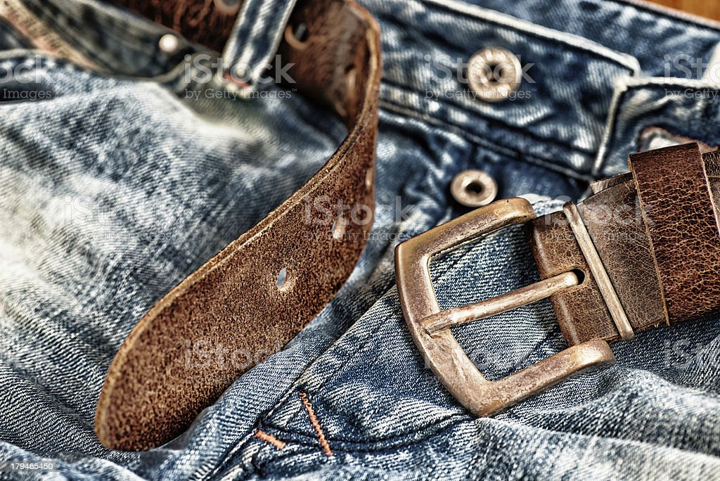 used blue jeans with brown belt royalty-free stock photo