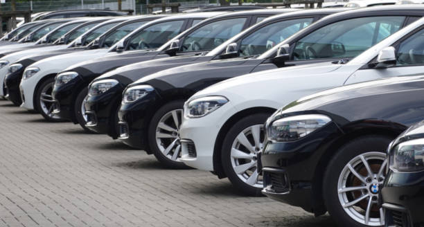 Used BMW cars parked at a public car dealership in Hamburg, Germany stock photo