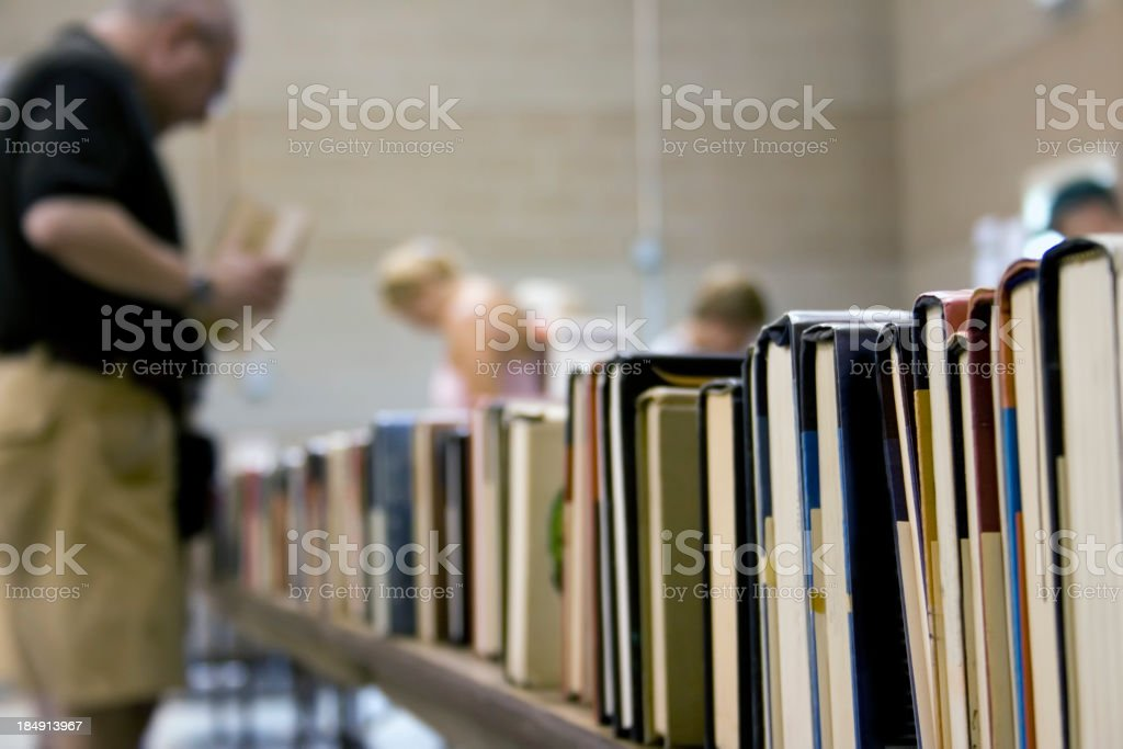 Used book sale with blurred people on the background stock photo