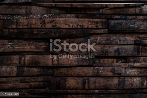 Used Bourbon Barrel Staves On Wall Background Image